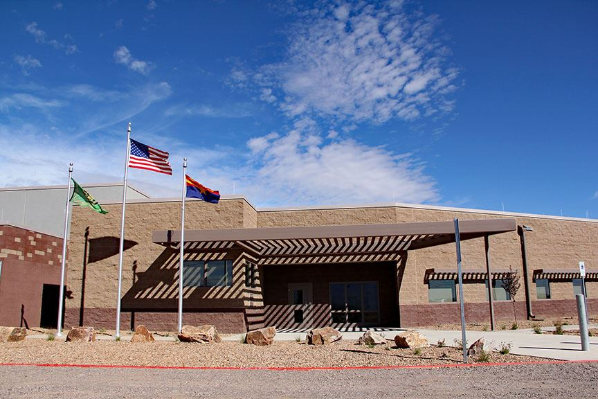 Sheriff's office entrance with flag poles