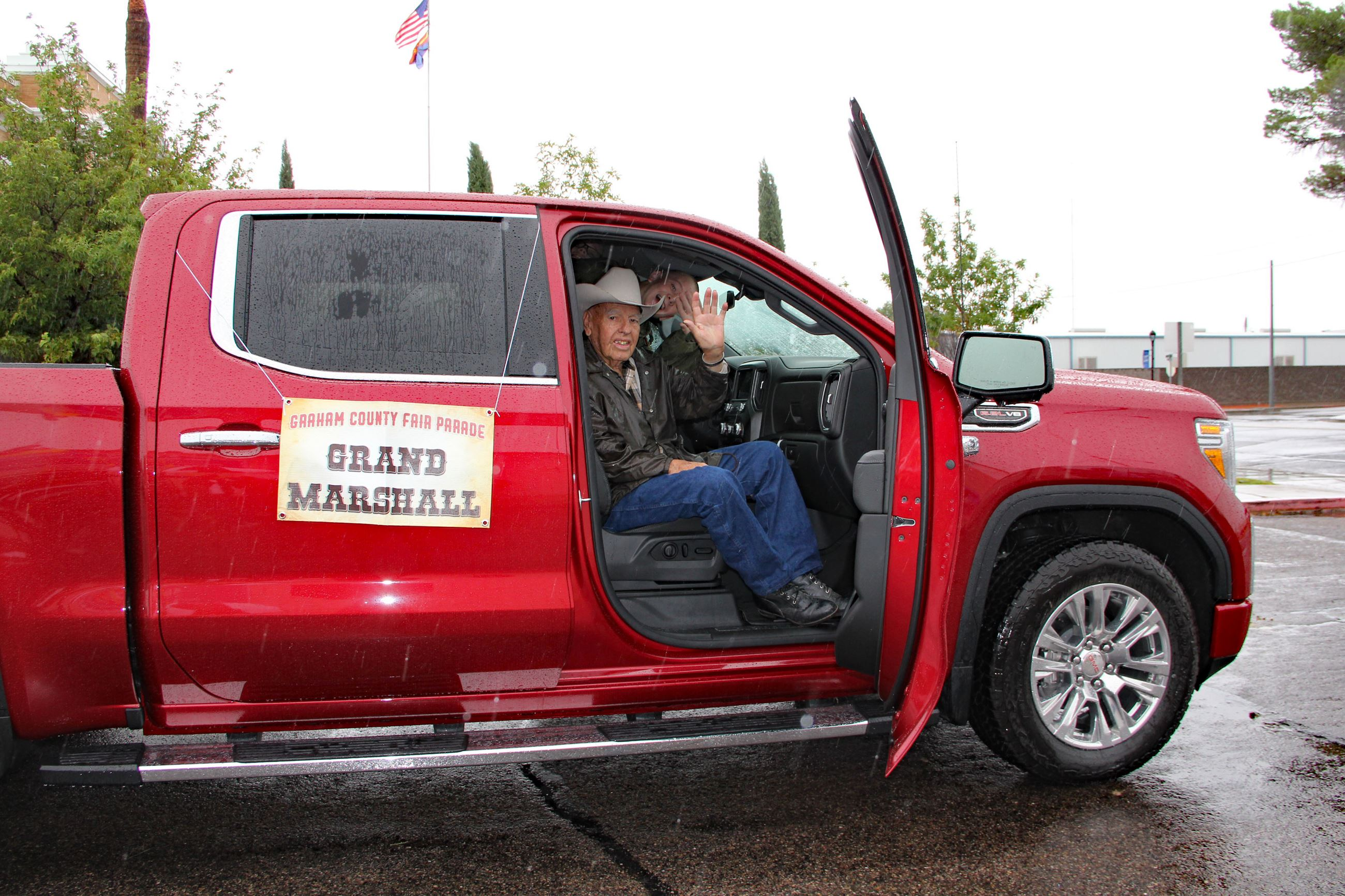 Grand Marshall in red pickup truck