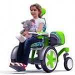 Child in green wheelchair